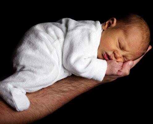 Baby sleeping on a hand